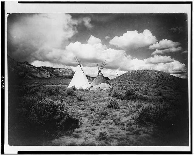 Two Apache Indian teepees in a hilly landscape in Arizona